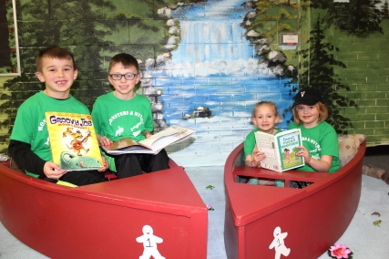 They can also choose to read in rowboats, traveling down an imaginary river. They are shown from left to right: Mason Keiser, Brighton Frakes, Quinley Lash, and Emelia Shafer.