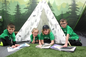Reading books can be a real pleasure when kids at Indian Lake Elementary get to curl up in a tent. They are from left to right: Mason Keiser, Quinley Lash, Emelia Shafer, Brighton Frakes.