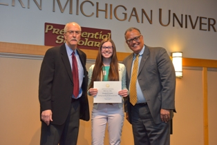 Nikki Callen receives her commendation award from WMU dignitaries.