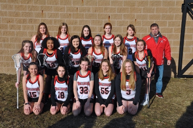 Girls Lacrosse Front row, left to right: Adele Wilson, Liz Yeck, Brooklyn Combs, Norah Palomalki, Maryssa Wright. Second row: Katie Wells-Schmidt, Kearah Williams, Jaci Spicer, Gabby Wright, Bailey Derrick. Third row: Isabelle Wilkinson, Hannah Johnson, Morgan Haddix, Bella Pence, Jennifer Converse, Head Coach Charlie Glascock. Not pictured: Taylor Miller, Jerrica Marietti, Isabelle Willis.