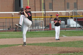 Joey McCowen is pitching and Parker Wilson is guarding first base for the Bulldog baseball team. Photo by Travis Smola.