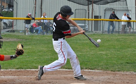 David Benedict makes good ball contact while batting for the Bulldogs. Photo by Travis Smola.