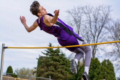 "Austin Webb clear 6'3"" in the high jump. Photo by Stephanie Blentlinger, Lingering Memories Photography."