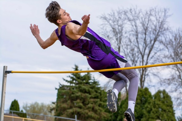 """Austin Webb clear 6'3"""" in the high jump. Photo by Stephanie Blentlinger, Lingering Memories Photography."""
