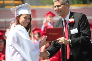 Adeline Reno receives her diploma from Vicksburg School Board Trustee Dr. David Schriemer.