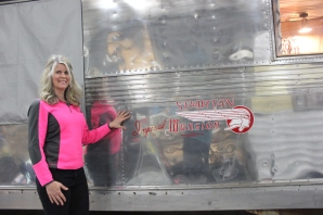 Sondra Phillips outside and inside her revamped vintage travel trailer.