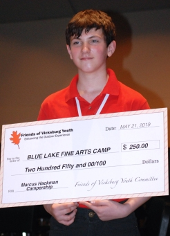 Marcus Hackman holds his giant check.
