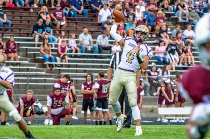 Quarterback Alex Thole prepares to pass in the game against Buchanan.