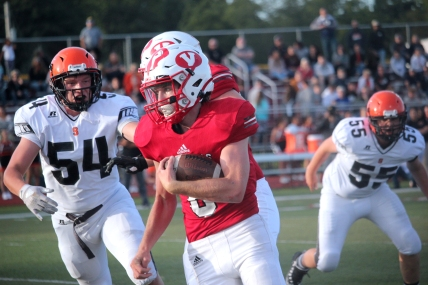 Jared Gorsline eludes Sturgis tacklers on a 84 yard touchdown run in the first play of the game.