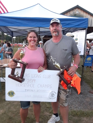 "Tiffany Bouvrette and Dave Benedict bested Scott ""Stubby Haynes"" and Jim Curtis in the final horseshoe pitching contest at the Lions Club B&B. Tiffany is the first female winner of the tournament in its 13 years and it was the first time winning for both she and her partner."