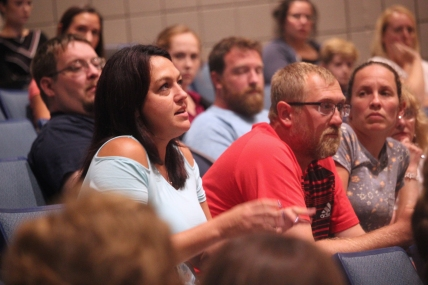 Audience members Nicole and Chad Kissinger ask questions of the school board.