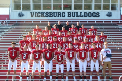 Varsity Football from left, first row: Jacob Conklin, Jacob Baird, Christian Roth, Jayce Todd, Zane Lehmkuhl, Jared Gorsline, Landen Balkema, Toby Stock, Carter Root. Second row: Chase Myers, Lucas Hatridge, Brendan Monroe, Ethan Razmus-Buscher, Cole Straka, Brian Roberts, Elijah Bombich, Brandon Thompson. Third row: Tanner Groves, Stephen Phelps, Stephen McCowen, Logan Sprinkle, Ben Hackman, Gunnar Niewiadomski, Carter Coffinger, Tyler Buddemeier. Fourth row: Collin Klinger, Kevin Munn, Brady Nason, Levi Sehy, Brandin Yant, Kyle Rose, Tim Axtell. Back row coaches: Cody Caswell, Tom Marchese, Brian Deal, Kurt Phelps.