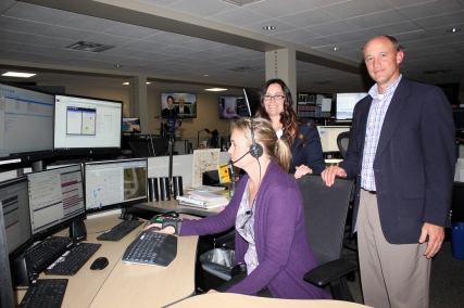 Marie Gleesing, Victoria Ros, and Jeff Troyer, in the 911 call center.