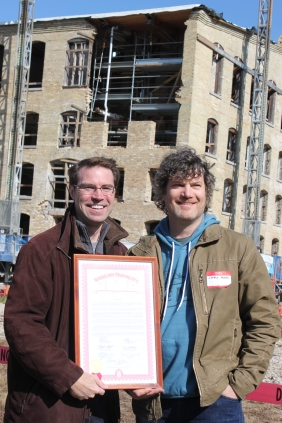 Chris Moore accepts a resolution from the Michigan Legislature and the Governor for his work to revive the Mill over the last four years and his plans for the future. He was presented with the proclamation by State Senator Sean McCann, on the left.