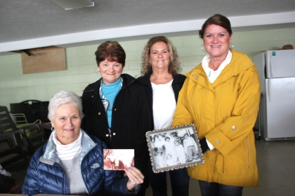 Left to right: Jill Blakeslee, Janet Knudsen, Jayne Engels, Judy Heeter. The five sisters are holding a picture on the left taken at the cottage of their Grandma Stender and her children the aunts and uncles of the current owners: Everett (Bud) and Pat Stender, Fran and Bill Woodhams, Helen and Harry Johnson, Eugene (Dude) and Eva Stender, Dorothy and Ed Talanda.
