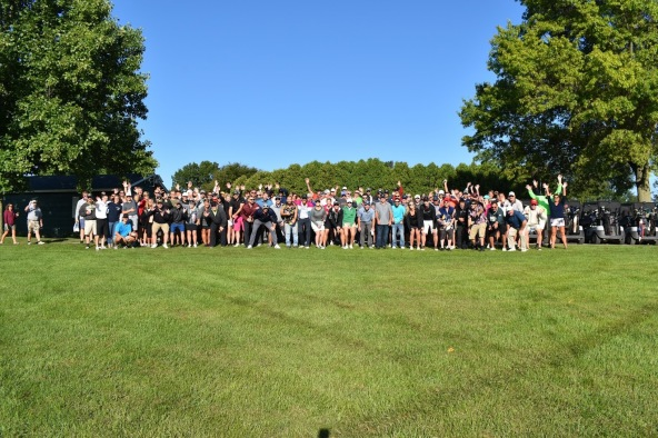 Taylor VanSchoick's supporters cheer him on at the recent golf fundraiser in his honor. Photo by Lisa Harbour.