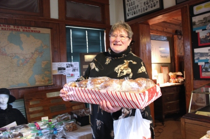 Donna Weinberg arrives at the Vicksburg Depot Museum with a tray full of her homemade bread for the Historical Society to sell at their annual bake sale fundraiser.