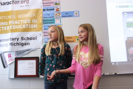 Camryn Rosier and Sophia Martin, students at Tobey, explain to the School Board about the traits it takes to be a National School of Character.