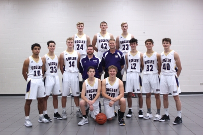 Varsity Basketball Kneeling in front from left: Carson Flynn, Aiden Hursey. Standing second row from left: Kobe Clark, Stephen Schultz, Trevor DeGroote, Assistant Coach Adam Sziede, Head Coach Randy Small, Terry Smith, Asher Puhalski, Skyler Thompson. Standing in back from left: Tyler DeGroote, Bryce VanderWiere, Tyler Rykse.