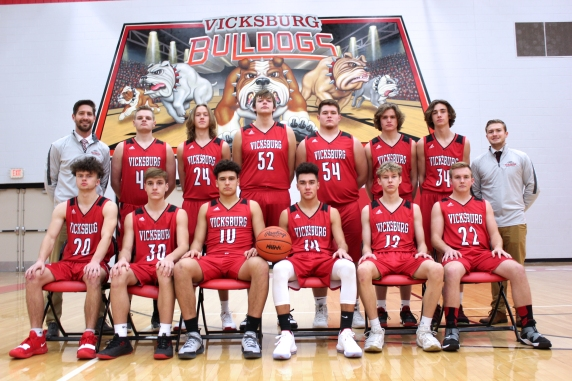 Varsity Basketball Seated from left: Ethan Buscher, Timmy Sarvari, Jacob Conklin, Chase Myers, Levi Root, Jacob Baird. Standing from left: Head Coach Josh Noble, Parker Wilson, Dillon Shook, Tyler Kienbaum, Kyle Rose, Lucas Hatridge, Drake Steele, Asst. Coach Nick Foley.