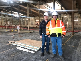Chris Moore along with Ronnie Goss of DeLisle Associates inspect the asbestos removal area and the brick walls that have received paint removal treatment in the east wing of the Mill.