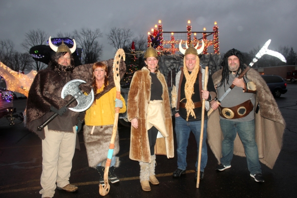 Frederick Construction float creators stand ready to roll in the Vicksburg Christmas in the Village parade.