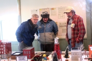Joe Timko, on the right, displays his train set up to visitors during the open house at the Historic Village.