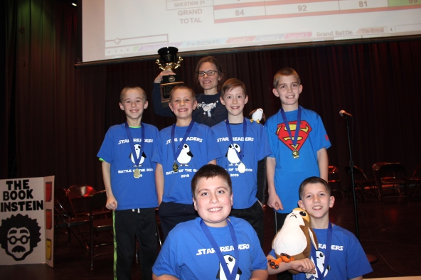 The 2019 winning team is shown here called the Star Readers. In the front row are Matthew Peters and Quincy Schwartz. Standing in back are Caiden Caswell, Isaac Sandelin, Oliver Hammond, Ian Triemstra. Holding the trophy in back is Faye VanRavensway. The team will be back in 2020 to challenge all the other teams.