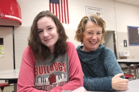 Cheyenne Lehmkuhl and Kathy Oswalt-Forsythe take a break from singing in the soprano section. They both have solo parts.