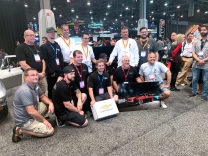 Dutchboys employees in the black shirts gather with all the guys that built the interior Avant-Garde Design for their winning hot rod on display in Las Vegas.
