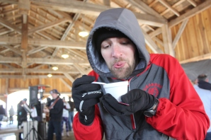 Lucas Wolthuis, 5K Chili Dash organizer, gets warm by checking out some chili in 2019.
