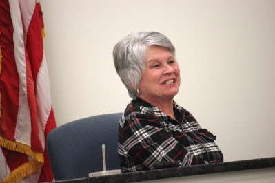 Schoolcraft Township Clerk, Virginia Mongreig, answers a question from the audience at the board's February meeting.