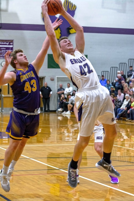 Bryce VanderWiere goes up high for a rebound. Photo by Stephanie Blentlinger, Lingering Memories Photography.