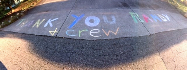 David MacKenzie helped a neighbor thank the Village crew for their continued good work by writing in chalk on the driveway.