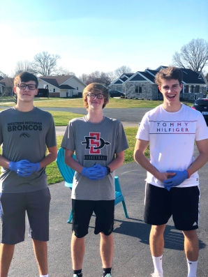 From left: Jackson Hambright, Ethan Cox, Levi Thomas in this before picture and with plenty of hair. Ben Hambright is not pictured because he wasn't sure he could take the big plunge.