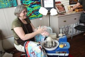 Lisa Beams at her pottery wheel.