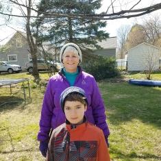 Nancy and David MacKenzie in their yard that faces Carol and Dan Niedzwicki's driveway.