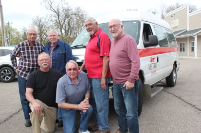 Drivers for the van that operates out of South County Community Services gather in front of their van. They are from left to right standing: Wes Bittenbender, Dale Holder, Chuck Vliek, Dave Carvell. Kneeling from left: Larry Forsyth and Bill Hunt.