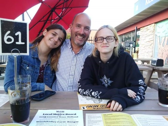 Sierra Scoffin, 8th grader at VMS, dad Brad Scoffin, and Amanda Scoffin, 10th grader at VHS, in glasses, pictured at One Well Brewing.