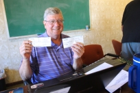 Wes Schmitt loves to receive donation checks.