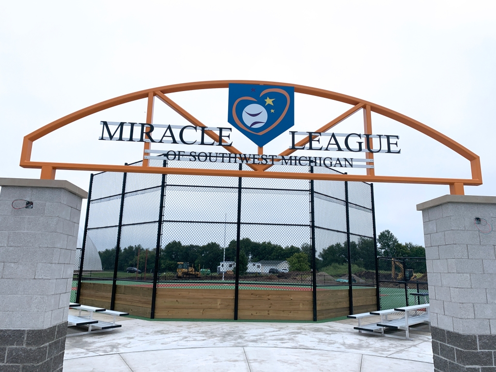 Left, entrance to the Miracle field. At right, an aerial view showing the layout of how the field will look when it is completed.